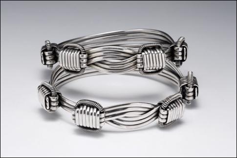 Mavros silver bracelets.