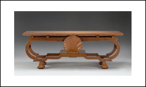 A RARE CARVED WALNUT CENTER / CONSOLE TABLE DESIGNED BY SIR EDWIN LUTYENS.