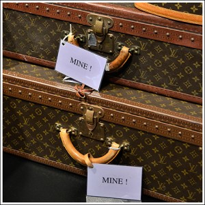 "Her Vuitton luggage tags read ""MINE!"""