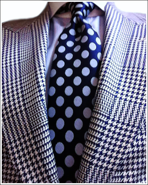 A Tom Ford royal blue glen plaid jacket, cobalt and pale blue polka dot silk tie, royal blue and white silk polka dot pocket square, pale blue pin point weave cotton shirt with contrast white collar.