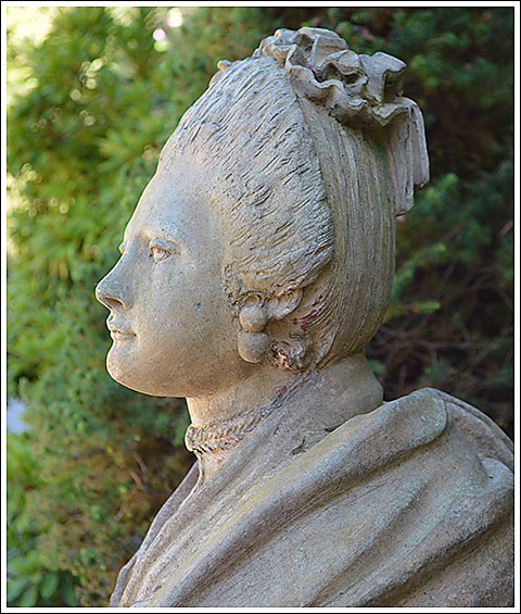 One of a pair of Madame du Barry sphinxes at the entrance to the Bianchi home