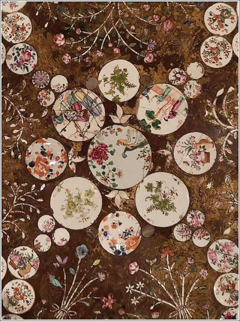 Detail of a George III birdcage tripod table top set with a decorative scheme employing Chinese and Japanese ceramic fragments and mother of pearl at Carlton Hobbs